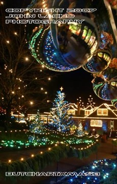 Christmas lights illuminate the darkness at Butchart Gardens outside of Victoria British Columbia during the Christmas season.