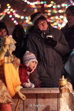 23Novembert2012   Bridget Maas, 4 of Sterling Heights and her grandmother Karen Maas of Kalamazoo look over the manger scene after the annual Tree Lighting Ceremony Friday evening at Bronson Park. (John A. Lacko / MLive)